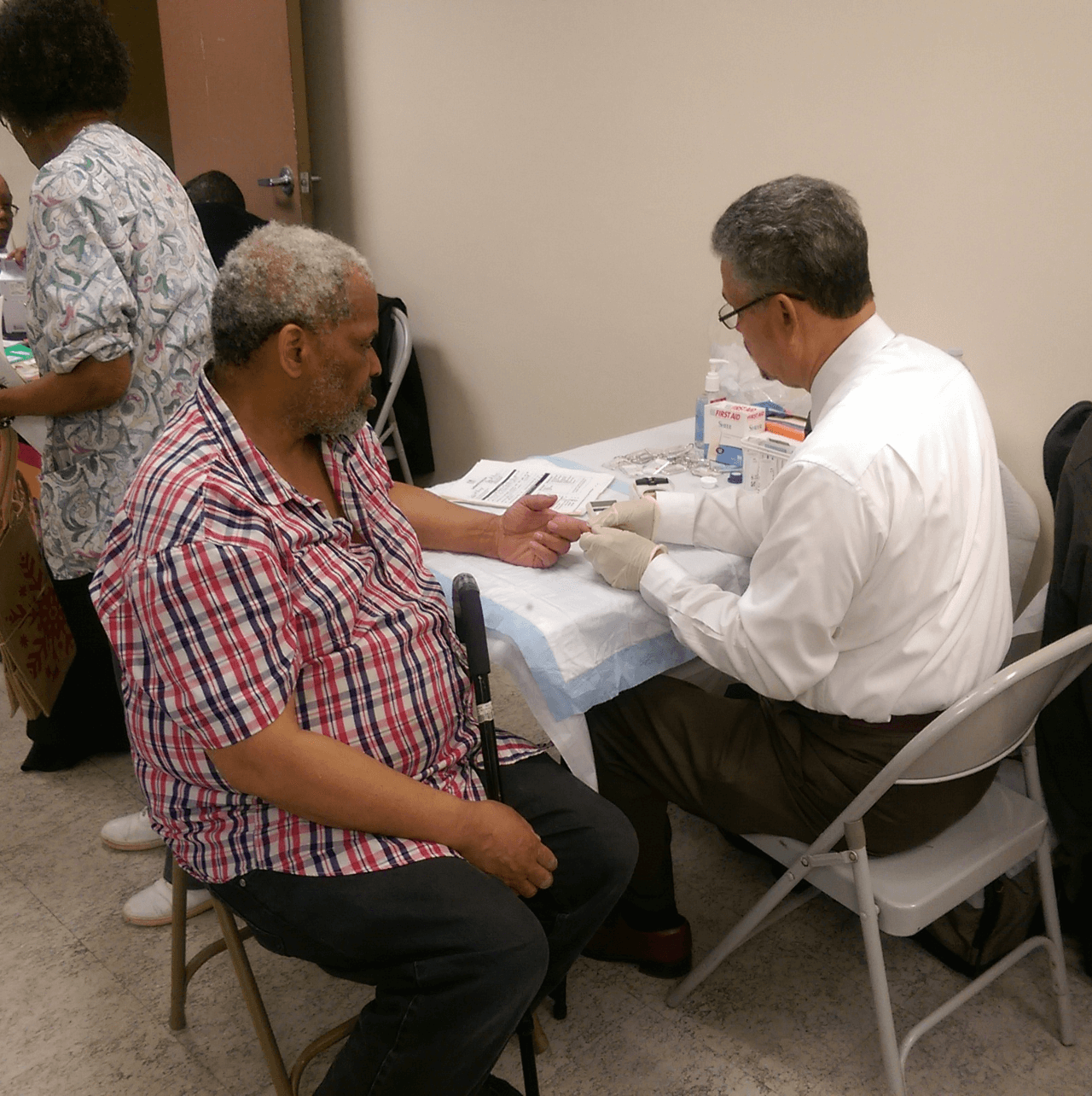 Resident having his blood sugar tested