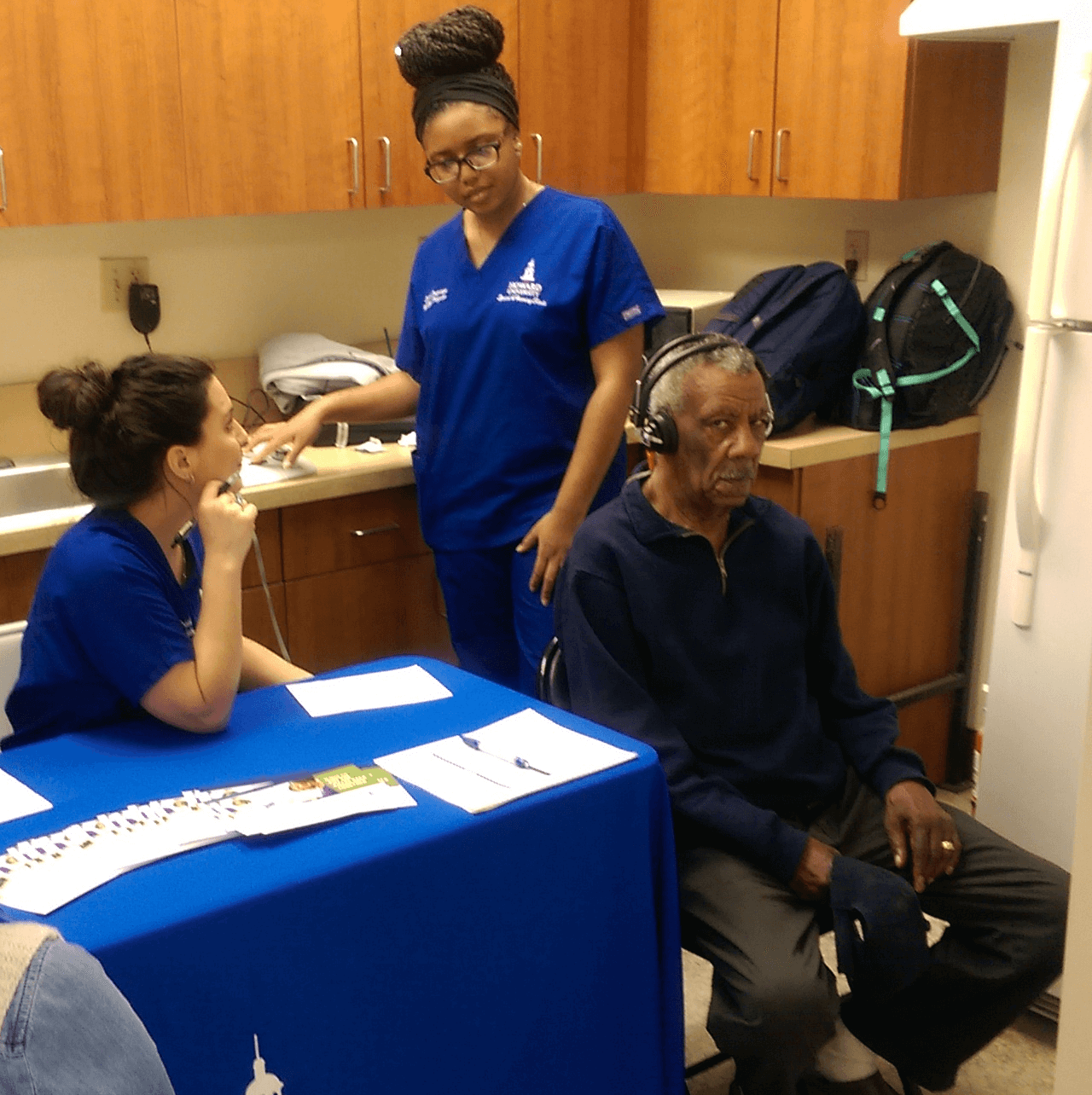 Hearing and Speech Pathology students conduct hearing test.