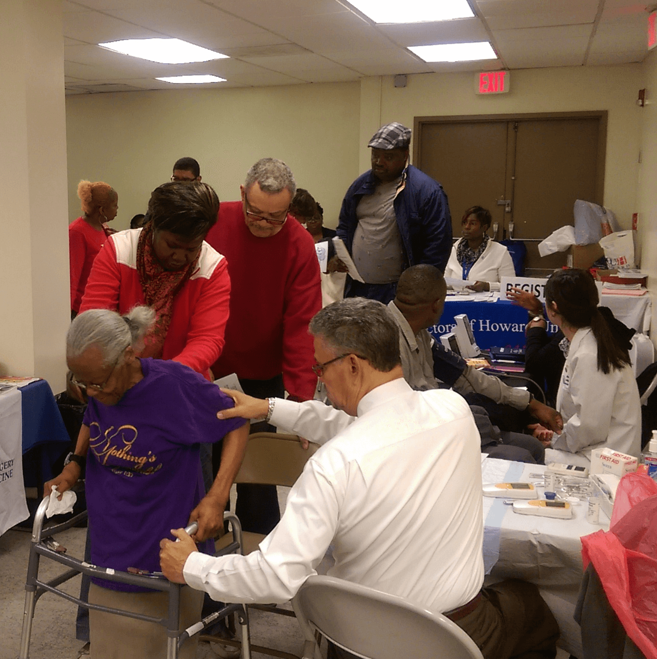 Residents receiving screenings and health information